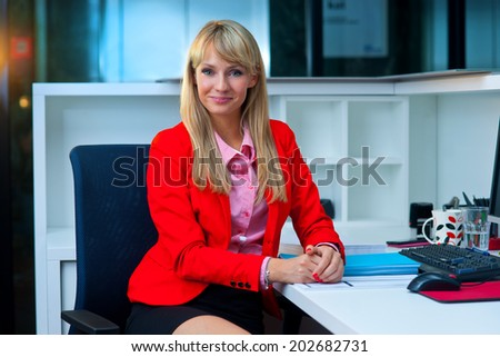 attractive blond business woman working in office
