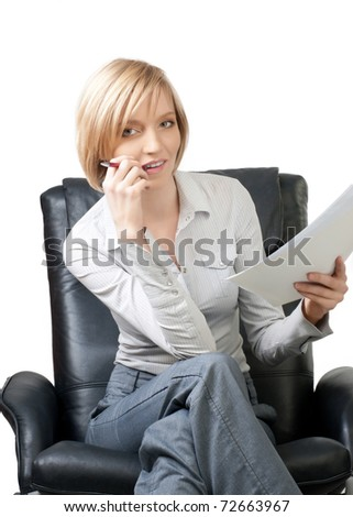Attractive blond businesswoman sitting in the armchair and checking the documents, isolated on white - stock photo