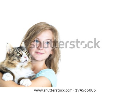 Attractive blond girl holding tiger tomcat looking right, copy space - stock photo