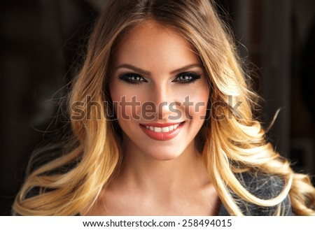 Attractive blond hair woman portrait with nice hairstyle. - stock photo