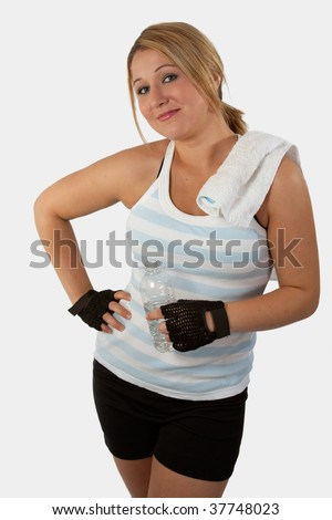 Attractive blond hair young woman with blue eyes wearing workout attire holding a water bottle - stock photo