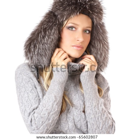 Attractive blond in a fur hat isolated on white - stock photo