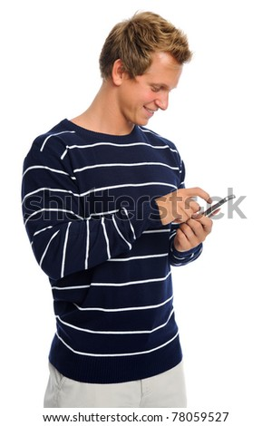 Attractive blond male holds his mobile phone and types out a text message - stock photo