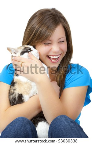 Attractive blond teen with a cat, laughing. - stock photo