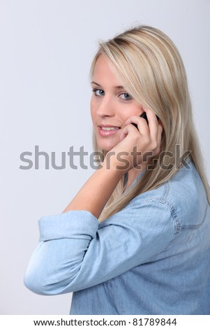 Attractive blond using mobile telephone