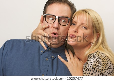 Attractive Blond Woman Attacks One Lucky Guy. - stock photo