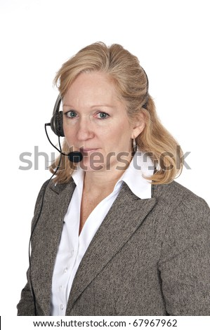 attractive blond woman in business attire wearing a headset on white background - stock photo