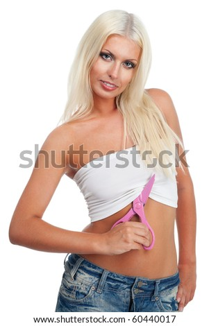Attractive blond woman ready to cut her clothes with scissors