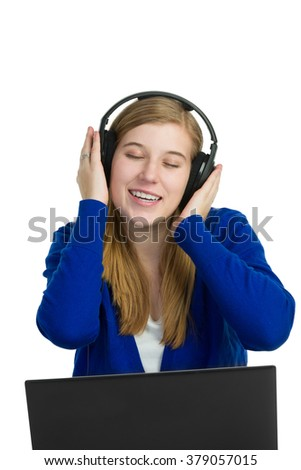 Attractive blond woman singing with headphones on - stock photo