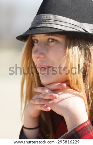 Attractive blond woman with a fedora - stock photo