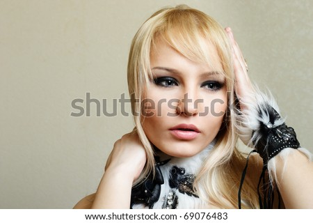 Attractive blond woman with hands on head emotional portrait