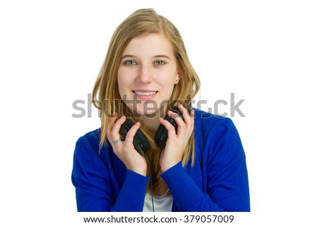 Attractive blond woman with headphones - stock photo