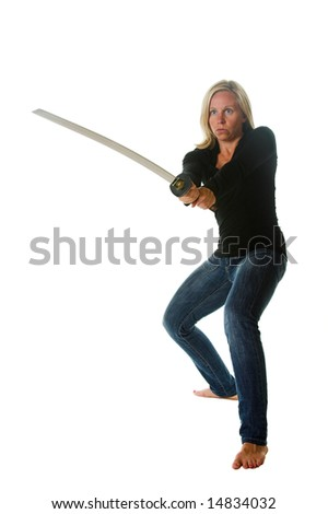 Attractive blond woman with samurai sword. Portion of photographers commission of this image will be donated to Autism Ontario.