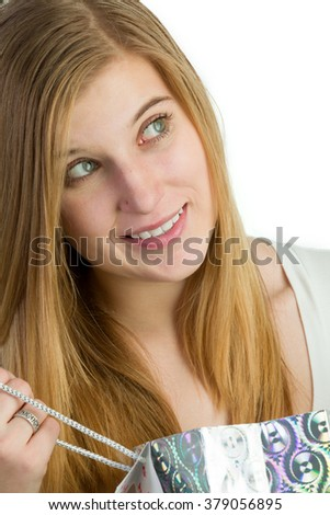 Attractive blond woman with shopping bags - stock photo