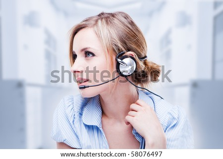 Attractive Blond Young Woman With A Telephone Headset - stock photo
