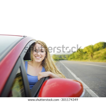 Attractive blonde behind the wheel of a new car on the road outside the city. White background instead of the sky for your text. Travel concept. - stock photo