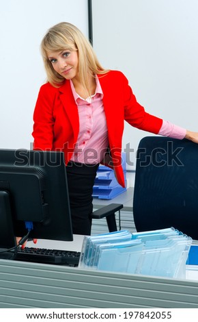 attractive blonde business woman in office workstation with computer