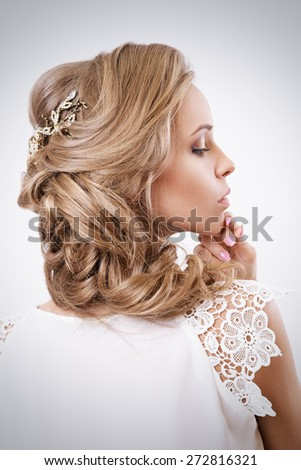 Attractive Blonde Curley Bride Portrait. Elegance Hairstyle And Accessories. Studio Photoshoot