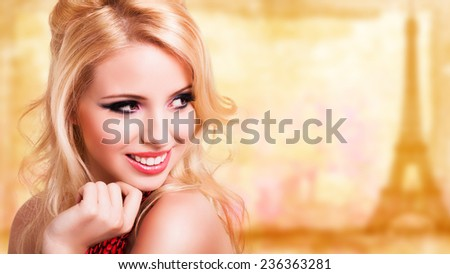 attractive blonde girl in front of a painted paris background - stock photo
