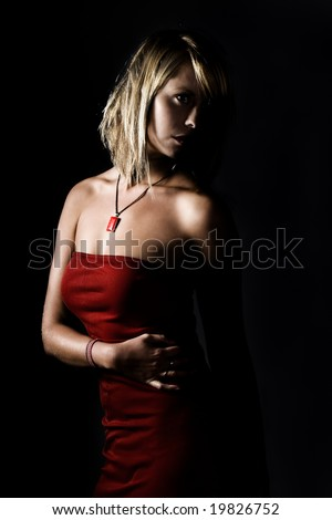 Attractive Blonde Girl in Red Dress Looking Away From Camera