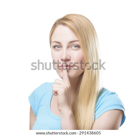 Attractive blonde holding a finger to her mouth. Isolated on white background. - stock photo