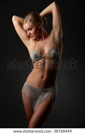 attractive blonde in her underwear from the rhinestone on dark background