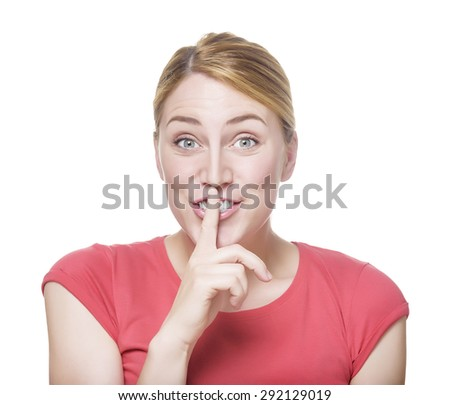 Attractive blonde in red t-shirt holding a finger to her mouth. Isolated on white background. - stock photo