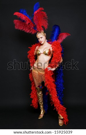 attractive blonde in stage costume over dark background
