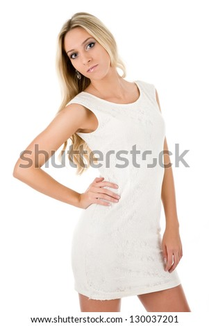 Attractive blonde in white short dress - stock photo