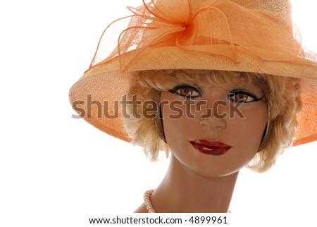 attractive blonde mannequin, large canteloupe hat isolated on white - stock photo