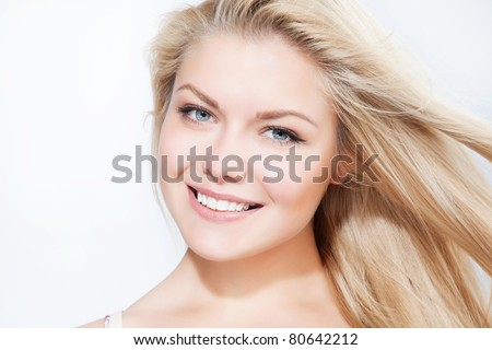 Attractive blonde smiling woman portrait on white background