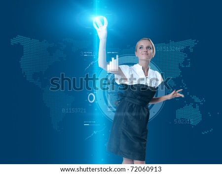 Attractive blonde touching the button in virtual future interface - stock photo