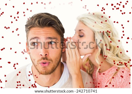 Attractive blonde whispering secret to boyfriend against red love hearts - stock photo