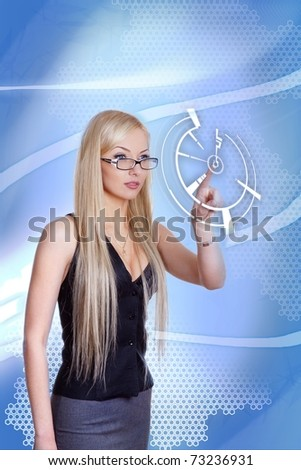 Attractive blonde with interface in futuristic interior (outstanding business people in interiors / interfaces series). Businesswoman pointing her finger on imaginery virtual button.