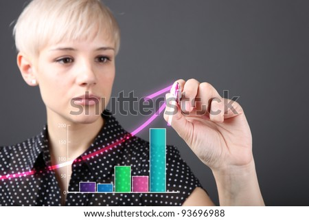 Attractive blonde with pen drawing growth (business people technology concept) - stock photo