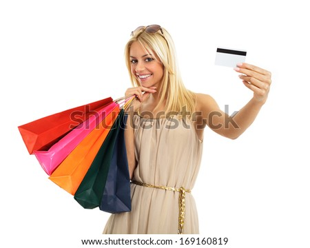 Attractive blonde with shopping bags and credit card in hand
