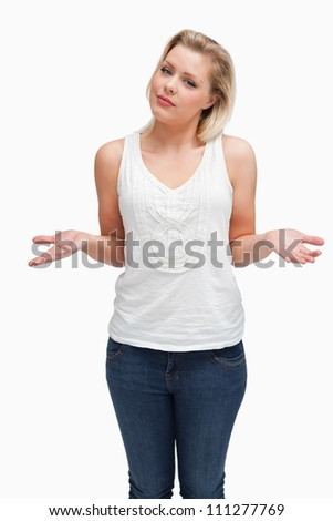 Attractive blonde woman extending her forearms against a white background - stock photo