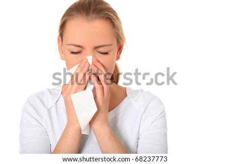 Attractive blonde woman using tissue. All on white background. - stock photo