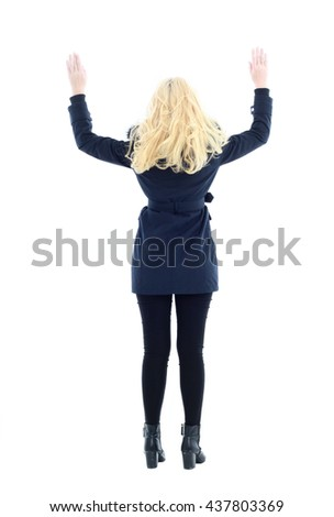 attractive blonde woman wearing dark blue winter coat with fur collar, standing pose. isolated on white background. - stock photo