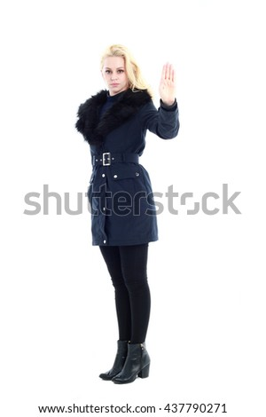 attractive blonde woman wearing dark winter coat with fur collar and boots. standing pose, isolated on a white background.