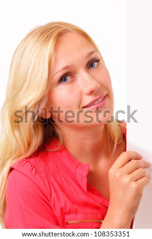 Attractive blonde woman with a sheet of paper - stock photo