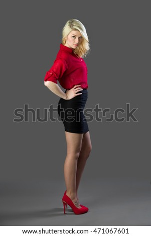 Attractive blonde woman with red shirt a black dress