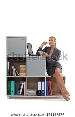 attractive blonde working on laptop indoors - stock photo