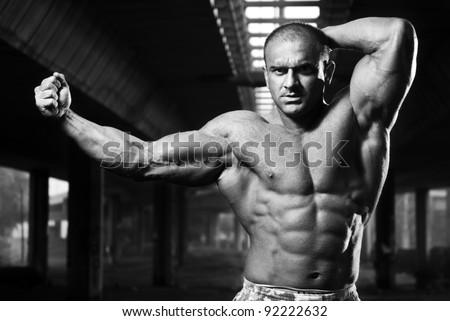 Attractive bodybuilder posing - stock photo