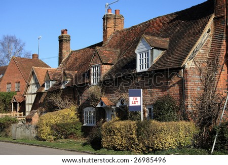 Attractive brick built cottage with a to let sign - stock photo