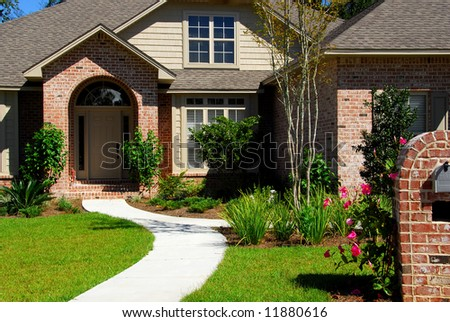 Attractive brick home and landscaping - stock photo