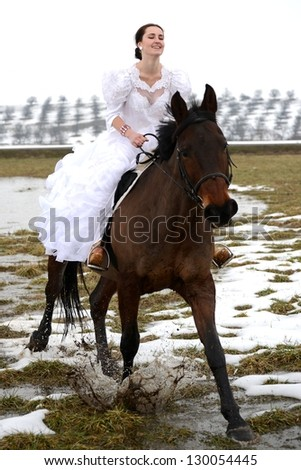 Attractive bride is sitting on the horse