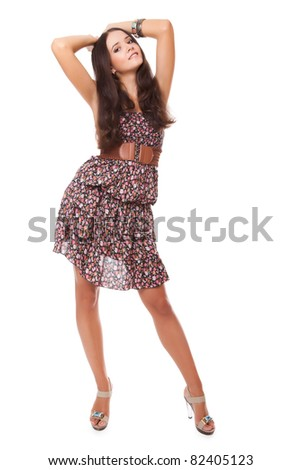 attractive bright young woman full-length on white background - stock photo