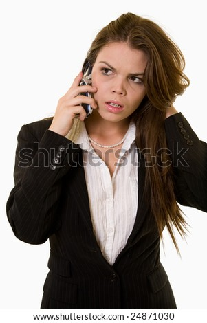 Attractive brunette business woman holding and talking on cell phone wearing a dark colored business jacket - stock photo