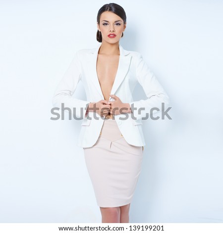 Attractive brunette business woman wearing white jacket - stock photo